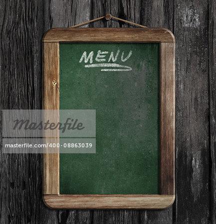 menu chalkboard or blackboard in restaurant on wooden wall