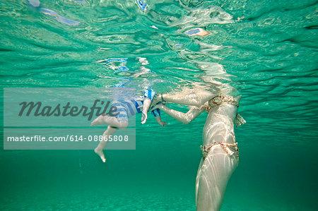 Mother teaching toddler to swim