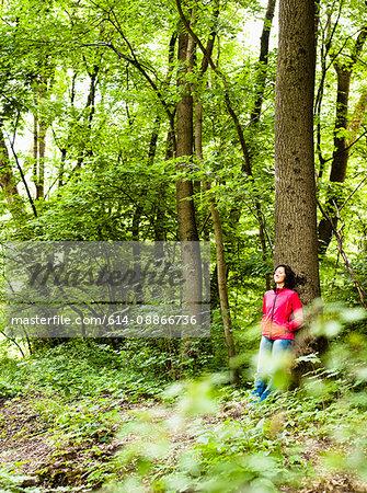 Woman Resting On Tree