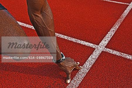 Sprinter's hand on start line