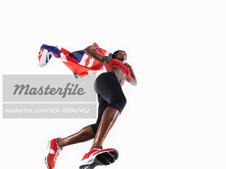 Female athlete running with union jack