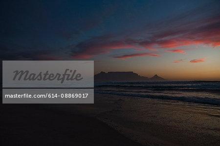 Sunset over deserted sandy beach