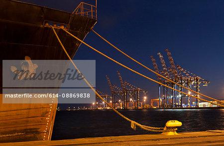 Ship docked in shipyard at night
