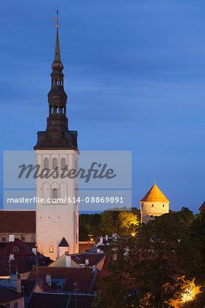 Church steeple lit up at night