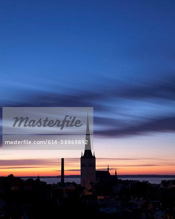 Silhouette of church steeple against sky