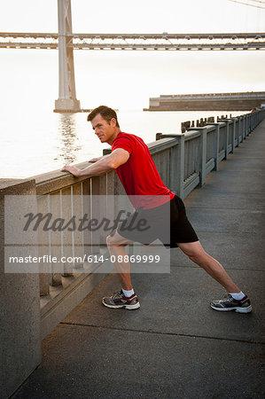 Man stretching on city street