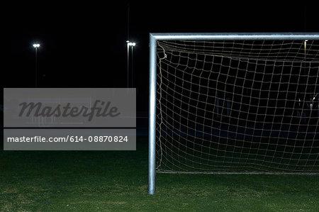 Soccer goal in field at night