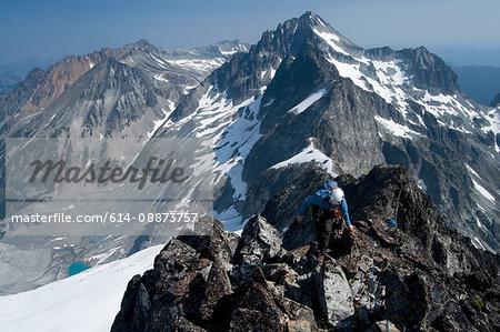 Female climber on mountain summit, Redoubt Whatcom Traverse, North Cascades National Park, WA, USA