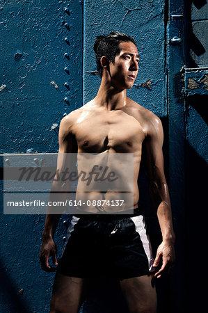Man in front of blue metal door