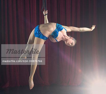 Female aerialist performing on rope