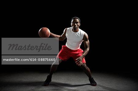Male basketball preparing to throw