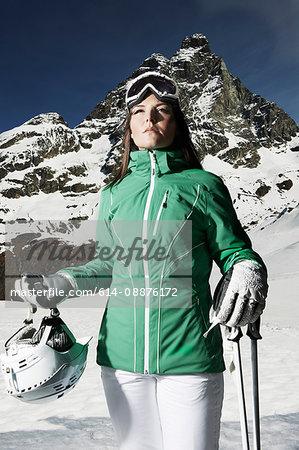 Portrait of female skier on mountain
