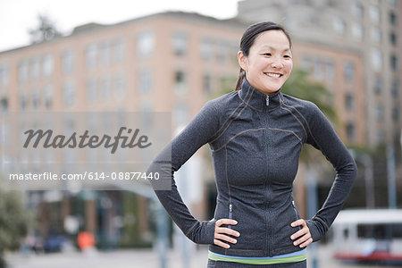 Female runner taking break in city centre, San Francisco, California