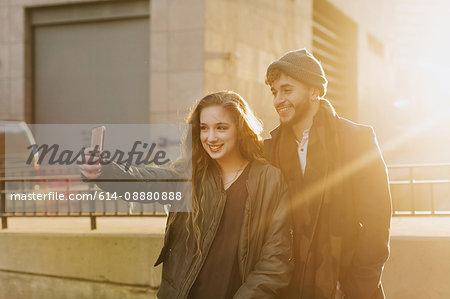 Young couple taking selfie in city, Boston, Massachusetts, USA