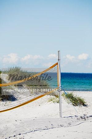 Volleyball net on sandy beach
