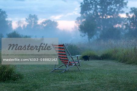 Empty sun chair at dusk