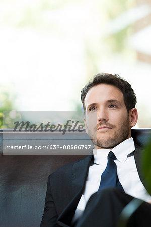 Business executive contemplating
