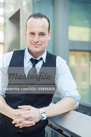 Confident businessman, portrait