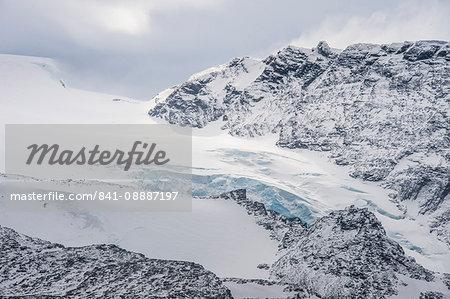 Glacier flowing down a mountain on Elephant Island, South Shetland Islands, Antarctica, Polar Regions