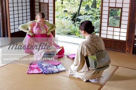 Caucasian woman wearing yukata at traditional Japanese house