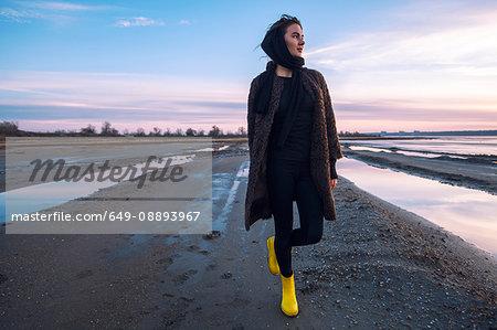 Woman enjoying beach at sunset