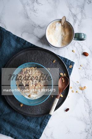 Breakfast with coffee, muesli and yogurt