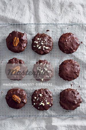 Vegan gingerbread biscuits covered in a dark chocolate glaze