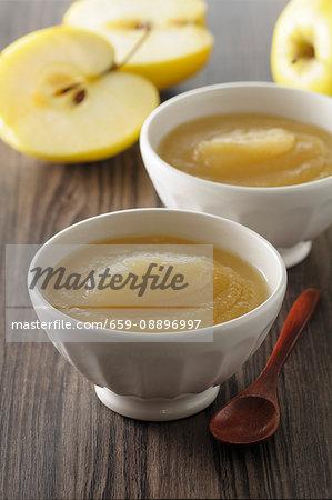 Fresh apple sauce in white bowls