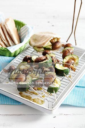 Grilled vegetable and mushroom skewers with pita bread