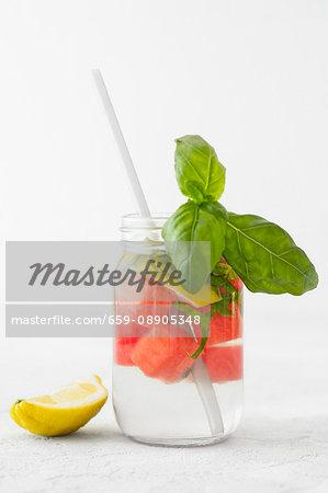 Detox water with melon, lemon and basil