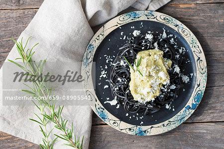 Black squid ink pasta with avocado pesto and Parmesan