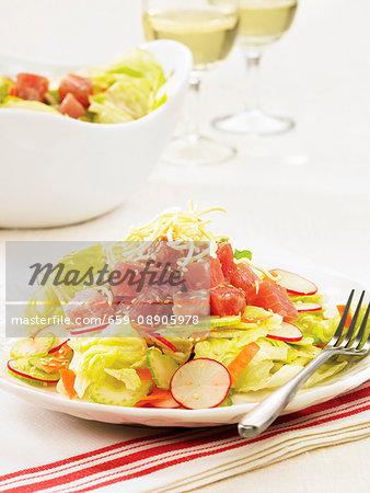 Tuna sashimi on a bed of leaf salad
