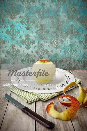 A peeled apple on a plate