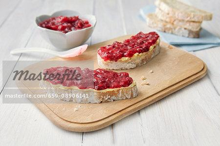 Raspberry jam on two slices of ciabatta bread