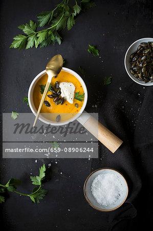 Pumpkin soup with crème fraîche and pumpkin seeds