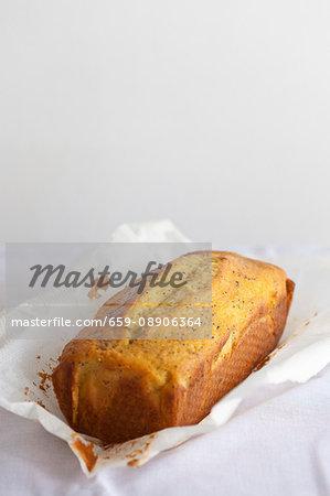 An orange & poppy seed loaf on baking paper