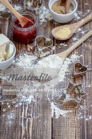 Ingredients for jammy shortbread biscuits: butter, flour, jam and demerara sugar