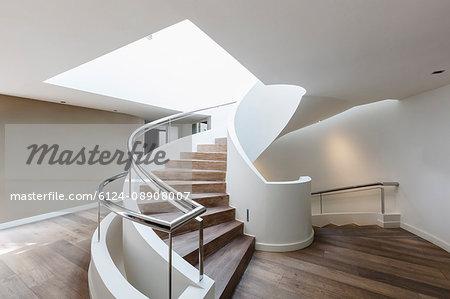 Wood spiral staircase in modern luxury home showcase interior