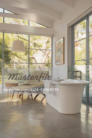 Soaking tub in luxury home showcase hotel bedroom