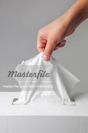 A hand seizing tissue
