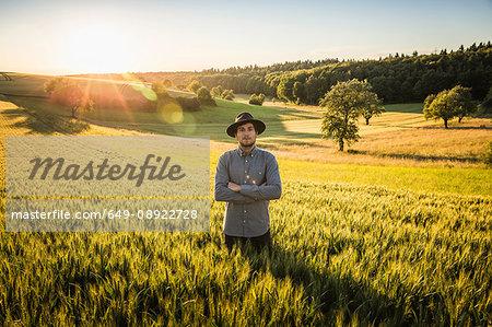 Portrait of mid adult man, standing in field, Neulingen, Baden-Württemberg, Germany