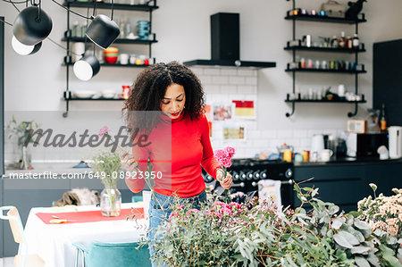 Female florist arranging flowers for flower arranging workshop display