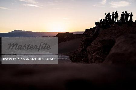 Silhouette of people on mountain at sunset, San Pedro de Atacama, Chile