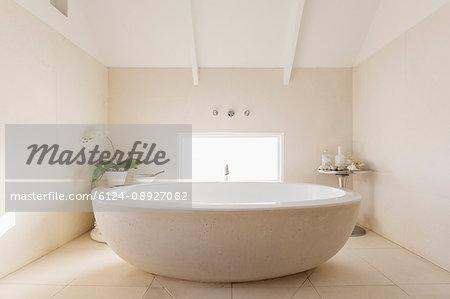 Round modern white luxury soaking bathtub