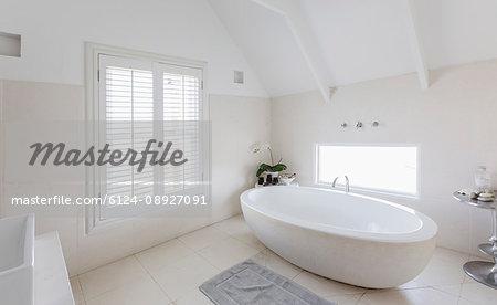Modern luxury white round soaking bathtub in bathroom