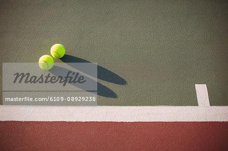 Close-up of tennis balls kept on court