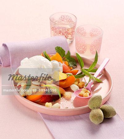 Fruit salad with lemon sorbet, white almonds and croutons