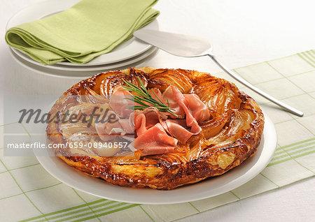 Onion tarte tatin with raw ham