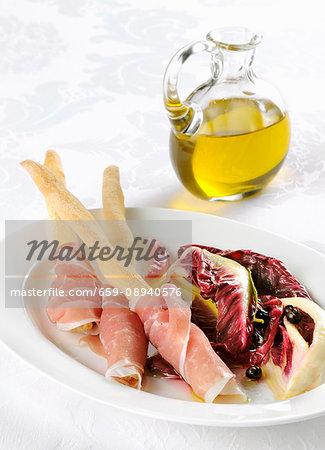 Breadsticks with San Daniele ham and a radicchio salad