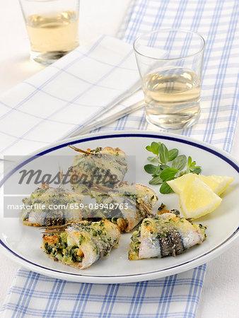 Rotolini di alici (sardine rolls, Italy)